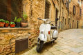Old vespa scooter on the street in italy Stock Image