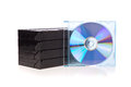 Old Video Cassette tapes with a DVD disc isolated Royalty Free Stock Photo