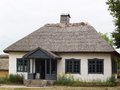 Old village school small made from clay with straw roof Royalty Free Stock Images