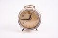 Old vintage alarm clock on white background Royalty Free Stock Photo