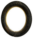 Old vintage antique wood round picture frame isolated an oval or the is weathered and scratched which adds to its charm on white Royalty Free Stock Images