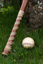 Old Vintage Baseball and Wooden Bat Royalty Free Stock Photo