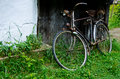 Old vintage bicycle near the house in the village Stock Images