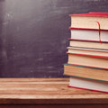 Old vintage books over chalkboard Royalty Free Stock Photo