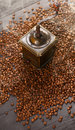 Old vintage coffee grinder on roasted hot beans with smoke Royalty Free Stock Photo