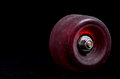 Old vintage consumed skate wheel on a black background Royalty Free Stock Image
