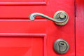 Old vintage door handle on red Royalty Free Stock Photos