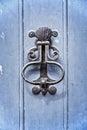 Old vintage door knocker on a blue wooden door Royalty Free Stock Photo