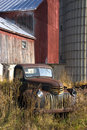 Old Vintage Farm Truck by Barn Royalty Free Stock Photo