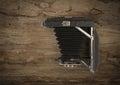 Old vintage folding camera on wood wooden white background Stock Photography