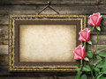 Old vintage frame for photos and a bouquet of yellow roses Royalty Free Stock Photo