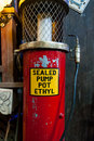 Old and vintage gas station sealed pump pot ethyl with fuel nozzle Stock Photo