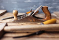 Old vintage hand tools on wood Royalty Free Stock Photo