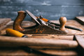 Old vintage hand tools on wooden background. Carpenter workplace. Royalty Free Stock Photo