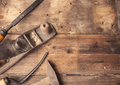 Old vintage hand tools on wooden background carpenter workplace tinted photo Royalty Free Stock Photography