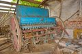 Old vintage industrial farmer tool plow in a abandoned ched Stock Image
