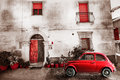 Photo : Old vintage italian scene. Small antique red car. Aging effect sky  table