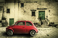 Picture : Old vintage italian scene. Small antique red car. Aging effect meatsauceprosciutto