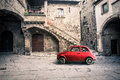 Old vintage italian scene. Small antique red car. Fiat 500 Royalty Free Stock Photo