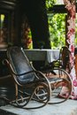 Old vintage leather rocking chair on the veranda Royalty Free Stock Photo