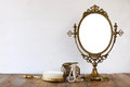 Old vintage oval mirror and woman toilet fashion objects Royalty Free Stock Photo