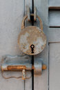 Old vintage padlock -  closed metal door Royalty Free Stock Photo