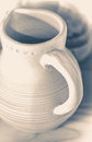 Old vintage photo. Jug of clay. Pitcher made of white clay. Royalty Free Stock Photo