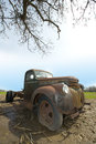 Old vintage retro antique rusting farm truck a unique angle of an chevrolet the chevy is resting in a field at an wisconsin Royalty Free Stock Photos