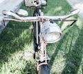 Old vintage rust bicycle a handlebar and light Royalty Free Stock Photos