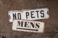 Old vintage signs no pets mens Stock Images