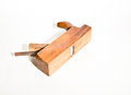 Old vintage smoothing plane on white wood crafting tool used to smooth boards background Stock Images
