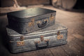 Old vintage suitcases in an attic a dusty Stock Photography