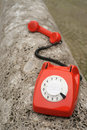 Old vintage telephone outdoors red retro phone series Stock Images