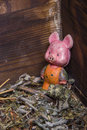 Old vintage toy - pig standing in old wooden chest. Royalty Free Stock Photo