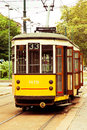 Old vintage tram in milan a symbol of the the and traditional orange waiting for passengers Royalty Free Stock Image