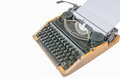 Old vintage typewriter with a blank sheet of paper inserted isolated Royalty Free Stock Photos