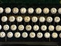 Old vintage typewriter letters keyboard alphabet circles Royalty Free Stock Photo