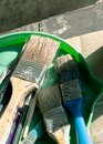 Old, vintage, used paint brushes in vary sizes in green plastic Royalty Free Stock Photo