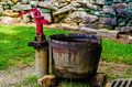 Old vintage water pump with a wooden bucket Royalty Free Stock Photography