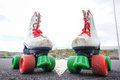 Old vintage white skate boot on the asphalt sterret Stock Photos