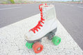Old vintage white skate boot hdr picture of on the asphalt sterret Stock Photo