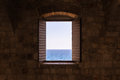 Old Vintage Window Open Shutters Looking Out at Ocean Castle For Royalty Free Stock Photo