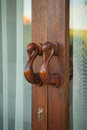Old vintage wood door handle Stock Images