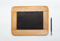 Old vintage  wooden frame blank slate and pencil Royalty Free Stock Photo
