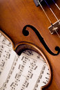 Old violin detail of an antique with notes Stock Photo