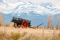 An old wagon car with a mountain backdrop Stock Photography