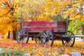 Old wagon red with autumn trees background Royalty Free Stock Image