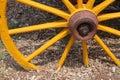 Old yellow wagon wheel Royalty Free Stock Photo