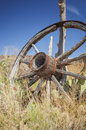 Old wagon wheel lone in a prairie utah Stock Photo