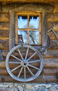 Old wagon wheel on wall Royalty Free Stock Photo